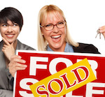 Real Estate Team with SOLD Sign
