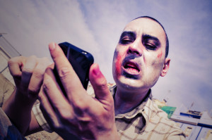scary zombie using a smartphone, with a filter effect